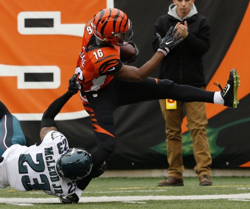 Cincinnati Bengals WR Cody Core (leg) carted off field at minicamp