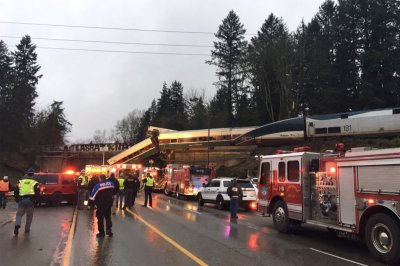 Amtrak chief 'sorry' for derailment near Seattle; NTSB looks for cause