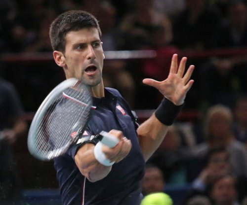 Djokovic, Wawrinka reach 3rd round in Oz