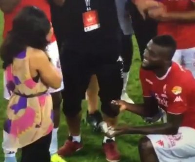 Nigerian midfielder John Ogu proposes on soccer field