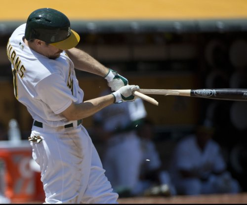Khris Davis homers again as Oakland Athletics' sweep Texas Rangers