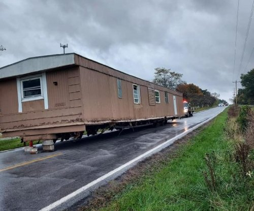Mobile home abandoned in the middle of Missouri road