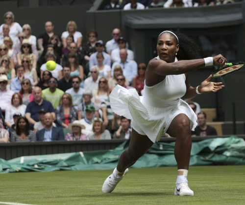 Serena tosses racket, fights into third round at Wimbledon