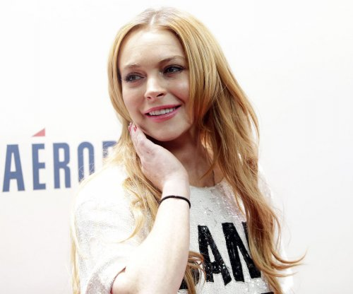 Lindsay Lohan says she was 'racially profiled' over headscarf