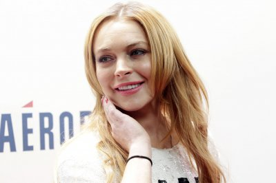Lindsay Lohan says she was 'racially profiled' over headscarf