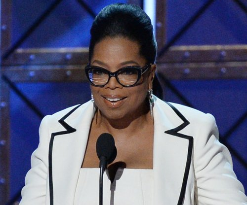 Oprah Winfrey warns fans of online imposter: 'It's a fraud!'