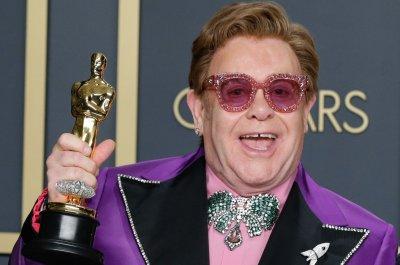 Elton John postpones tour dates, 'The Witcher' halts production