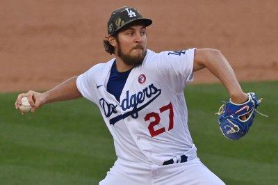 MLB places Dodgers pitcher Trevor Bauer on leave amid investigation