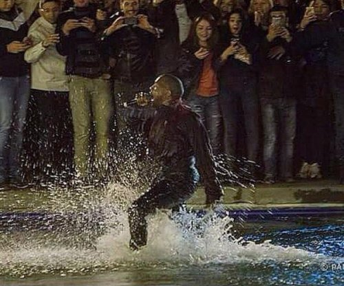 Kanye West jumps in Armenian lake, crowd follows