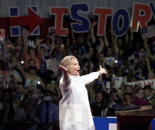 Clinton stakes claim to Democratic nomination on historic night