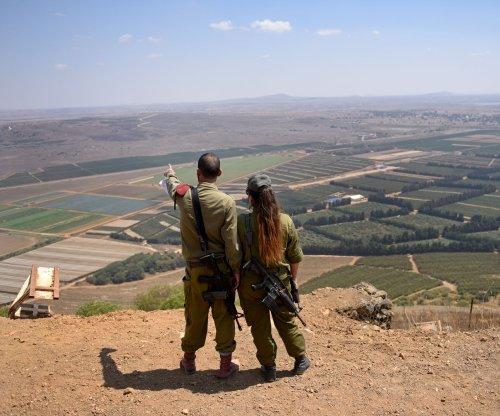 Syria says it downed warplane, drone near Golan Heights; Israel denies
