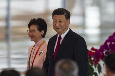 Xi supports Hong Kong's Lam at meeting
