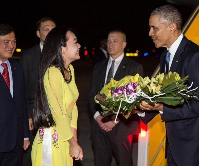 Obama gets rock star treatment as he warns against climate change in Vietman