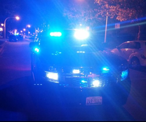 Manhunt underway after two Chicago police officers shot