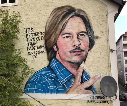 Bizarre mural depicts David Spade next to Kurt Cobain quote