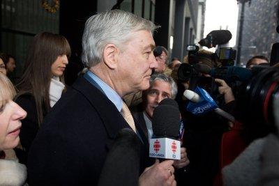 Trump pardons 2, including former Canadian media mogul jailed for corruption