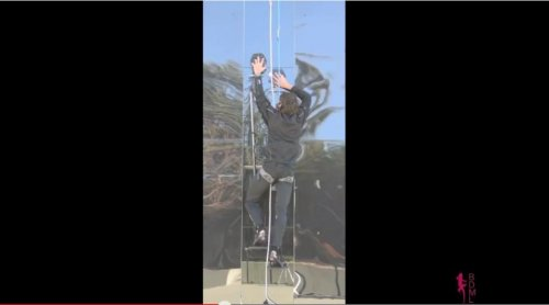 Gecko-inspired tech allows man to climb glass wall