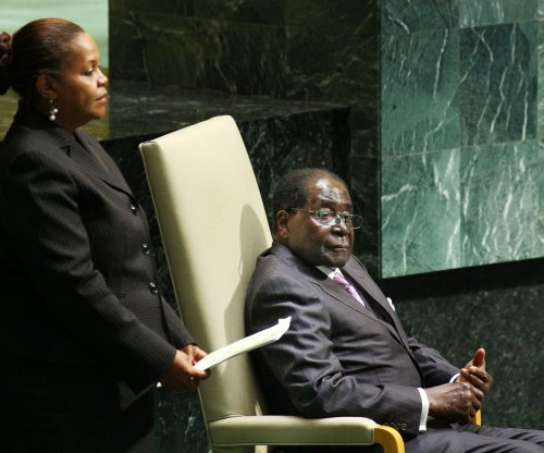 Zimbabwe's Mugabe fires vice president accused of assassination plot