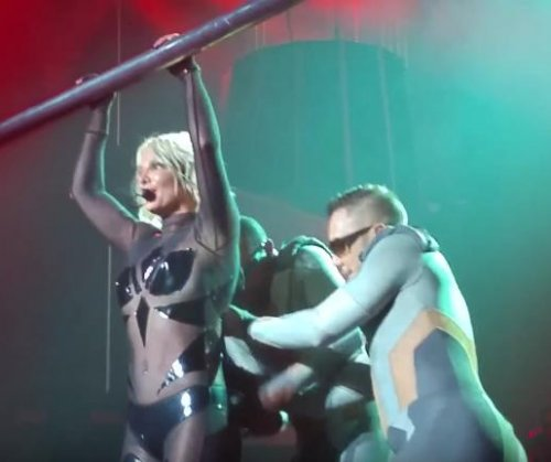 Britney Spears dances through wardrobe malfunction