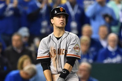 Buster Posey, San Francisco Giants rally past Los Angeles Dodgers in 10th