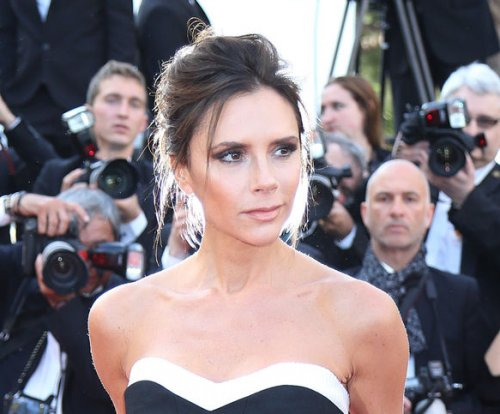 Victoria Beckham says she regrets having breast implants