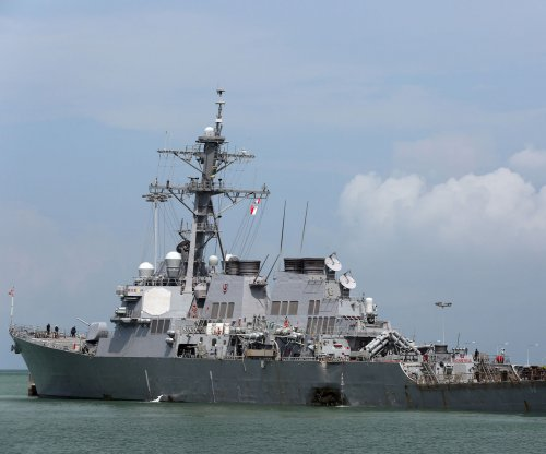U.S. Navy IDs missing sailors, calls off search near Singapore