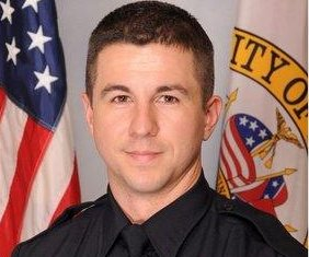 Police officer killed in Alabama while serving warrant