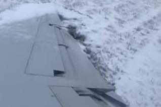 American Eagle flight slides off runway in dramatic video