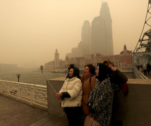China takes climate mantle from U.S., Greenpeace says
