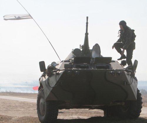Putin accuses Ukraine of 'stupid' acts in Crimea; Poroshenko says claims 'preposterous'