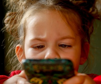 Kids spend more time on smartphones, tablets than parents realize