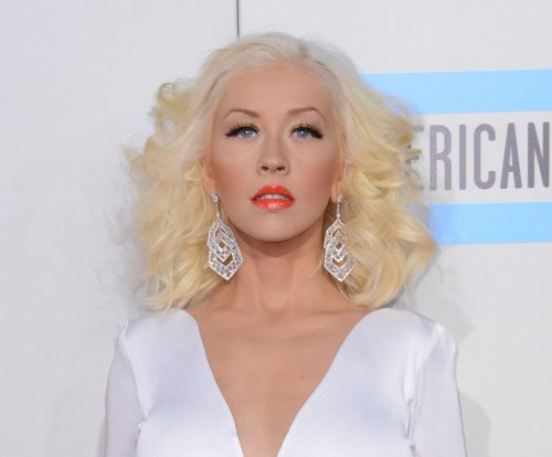 Christina Aguilera talks problematic expectations put on mothers