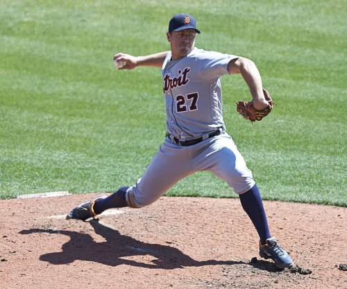 Strike-throwing Jordan Zimmermann pitches Detroit Tigers past Kansas City Royals