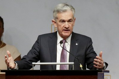Fed hikes interest rate one-quarter point