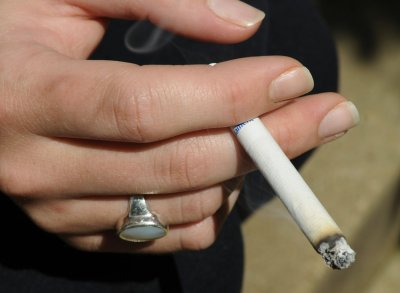 Maker of Camel cigarettes bans smoking in workplace