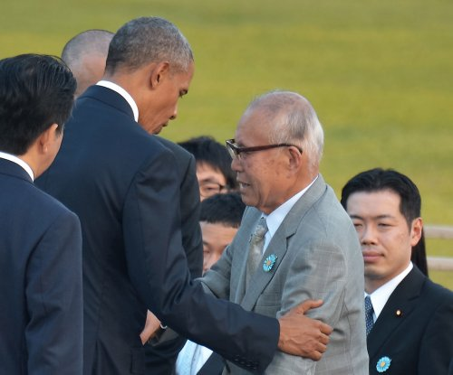Obama meets survivors in emotional visit to Hiroshima memorial
