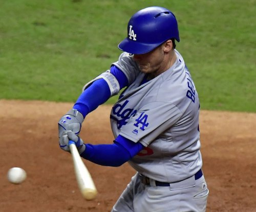 Dodgers swinging for sweep of rival Giants