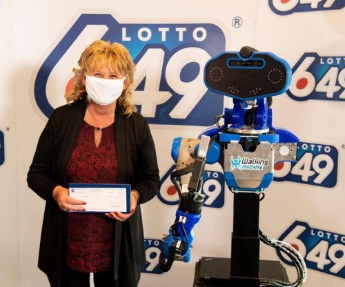 Human-sized robot presents lottery winner with check in Quebec