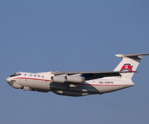 Chinese military intelligence aircraft seen over islands in South China Sea