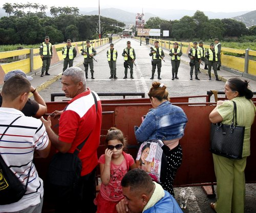 Venezuela re-opens border with Colombia