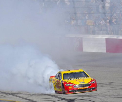 Joey Logano roars from the back of the pack to victory in Richmond
