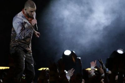 LeBron James delivers shots to Justin Timberlake while on stage