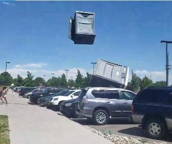 Strong wind sends portable toilets flying through the air