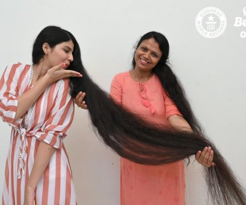 Guinness record holder gets first haircut in 12 years, donates locks to museum