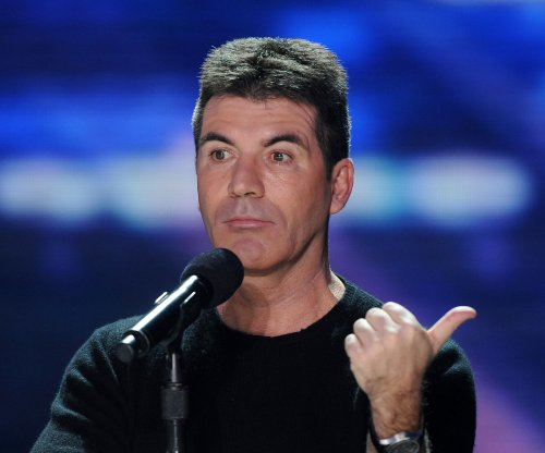 Simon Cowell robbed while at home with his family