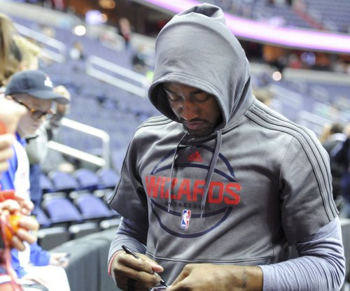 John Wall signs 4-year, $170M pact with Washington Wizards