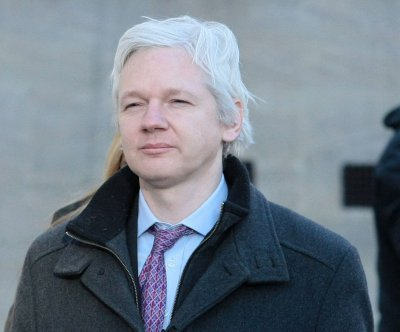 Swedish official rejects Assange's request to lift warrant so he can attend funeral