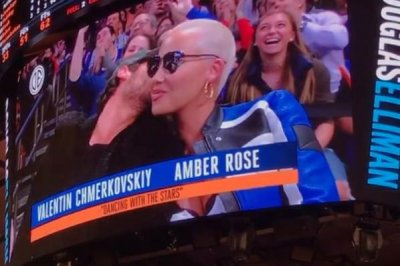 Amber Rose, Val Chmerkovskiy smooch for kiss cam