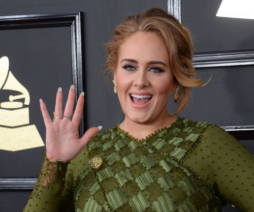 Adele sweeps the Grammy Awards, winning Best Album; Beyonce performs while pregnant with twins