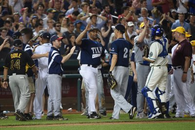 Democrats beat Republicans on ballfield, raise $1M for charity